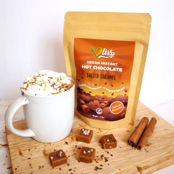 Pouch of Vliss Salted Caramel flavour vegan instant hot chocolate with caramel pieces